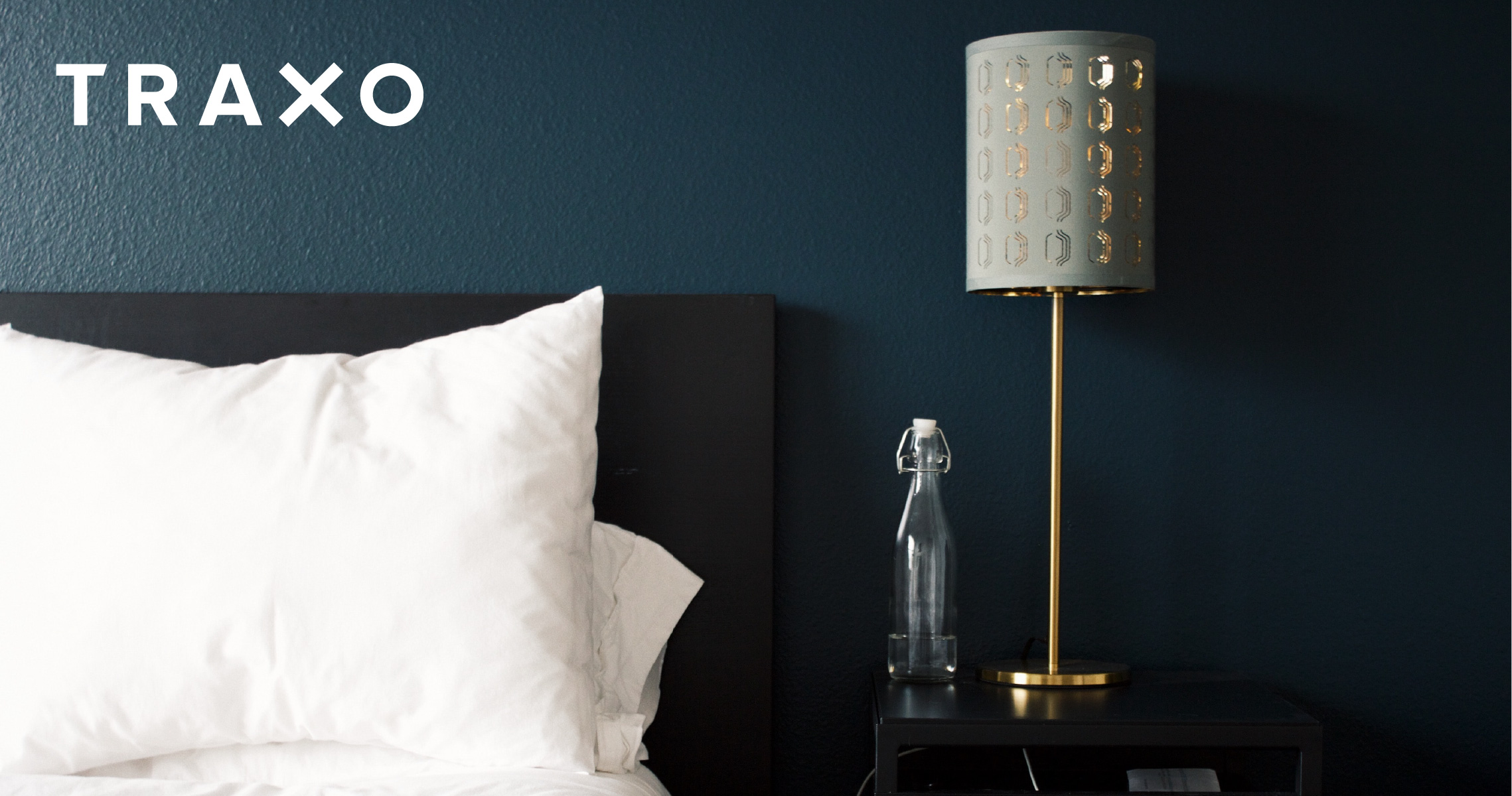 Decorative Image - Hotel Bed with Traxo Logo